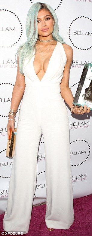 'I've definitely filled out': Kylie Jenner said on Monday that her curvier figure is due to weight gain, as she once again denied having breast implants. She is seen left in July and right in May 2014