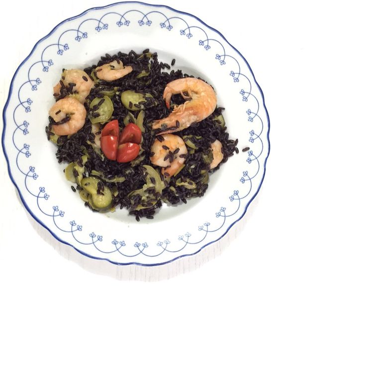 Black rise with zucchini and shrimps