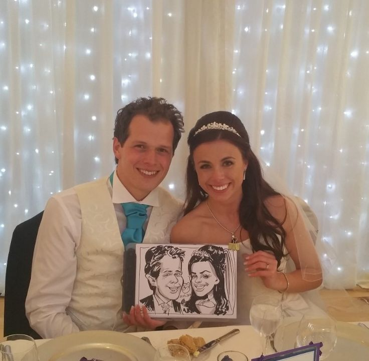 Black and white on the spot caricature of a bride and groom at their wedding.