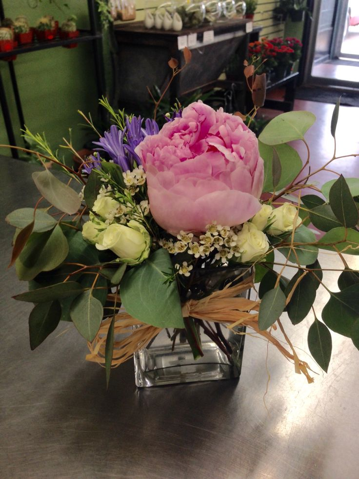 Thinking back to our wedding with this peony, eucalyptus and agapanthus arrangement.