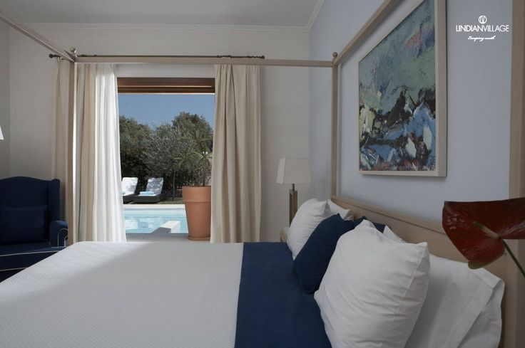 Select River Passage Pool Suite, a splendid place dressed in blue and white offering supreme accommodation.