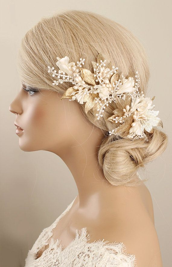 *Gougers handmade ivory flower with gold leaves hair accessory. It is perfect accessory for bride, bridesmaids or lots of special days.  *Size approximately  *Color -Ivory -Gold -Diamond  *Materials -Ivory silk flowers -Gold leaves -Ivory Pearls -Rhinestones -Hair comb  **each of my creations is made of high quality materials.  ★ Please read my Shop Policies and Shipping guide carefully. https://www.etsy.com/au/shop/GadaByGrace/policy?ref=shopinfo_policies_...