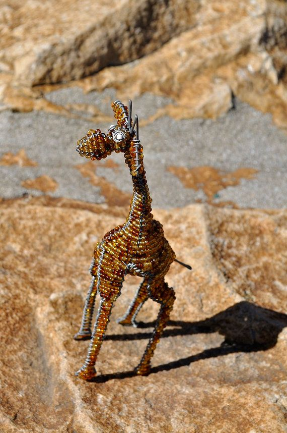 Brown beaded giraffe African wire sculpture by akwaabaAfrica, $16.00Use this handcrafted giraffe to bring African life to a garden or any ornamental display in the office or home.