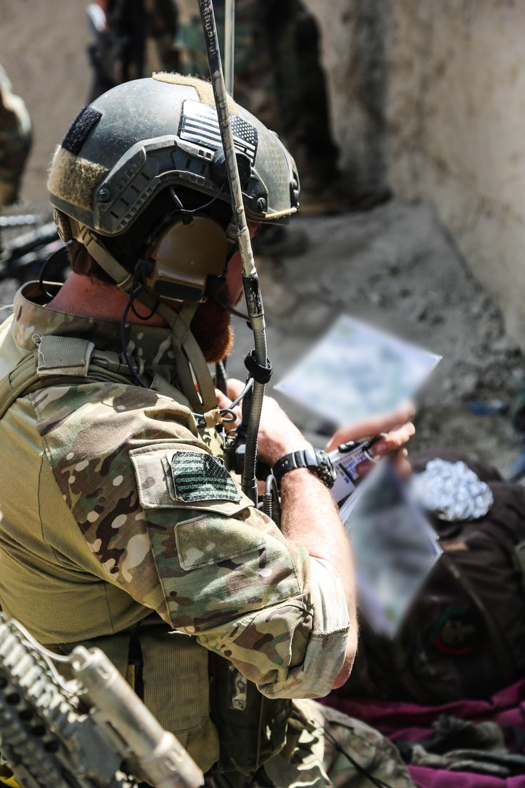 a us special forces soldier attached to combined joint special operations task force afghanistan refers to his map during an operation in khogyani