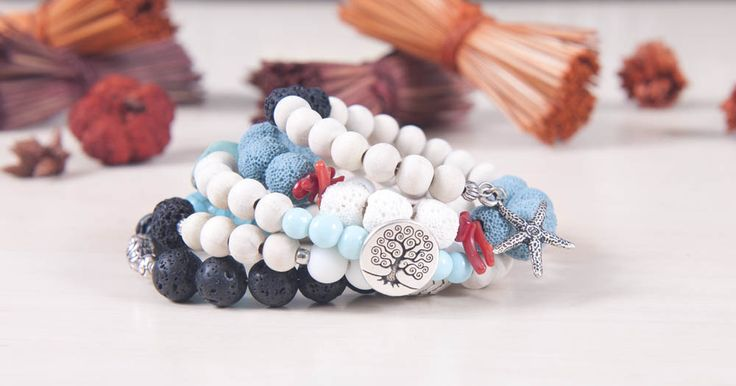 Memory wire bracelet with black & blue lava, red coral, turquoise & white wooden beads. With swallow, tree and sea star charms Made with memory wire, no clasp, fits all sizes