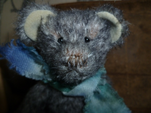 A close up of 'Enry's' face, showing his hand stitched nose and scarf.