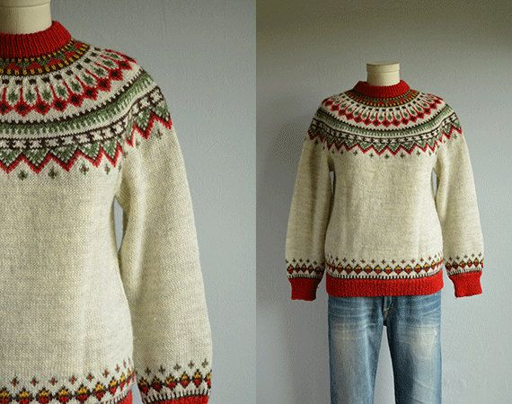 This beautifully handknit nordic sweater is knit in a palette of red, chocolate brown and soft pine green against an oatmeal colored ground. Easy