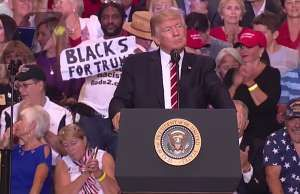 The strange story of that 'Blacks for Trump' guy standing behind POTUS at his Phoenix rally