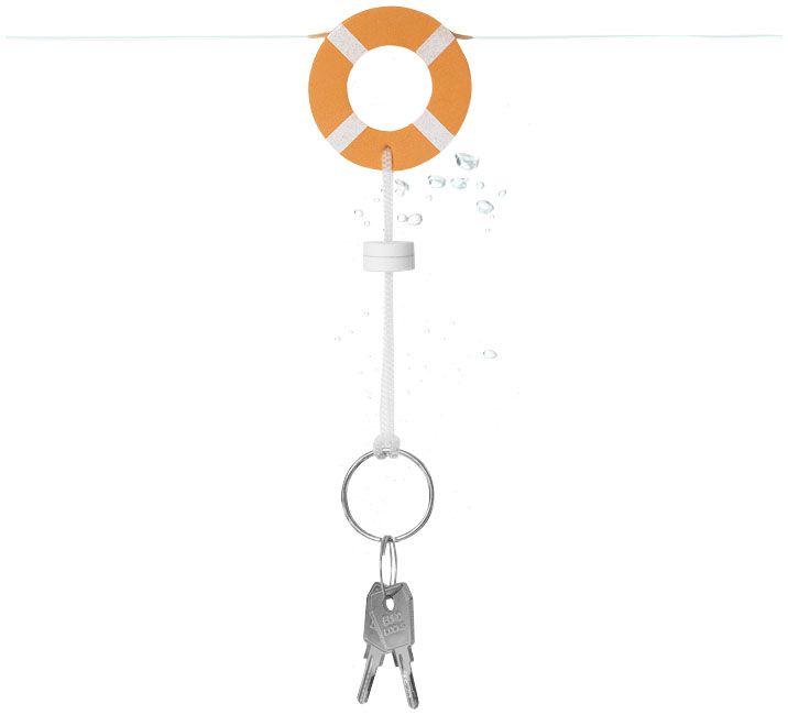 Llavero flotante.  Llavero boya salvavidas.  Material: Espuma de pu.  Dimensiones: Altura 0,8 cms. Diámetro: 5,50 cms.