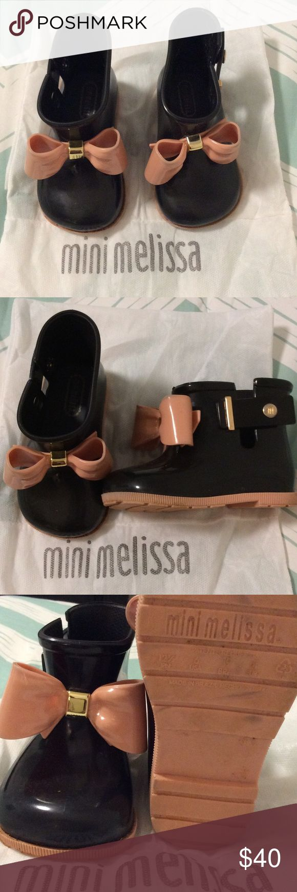 Mini Melissa Sugar Rain Boots in Black size 6 Mini Melissa Sugar Rain Boots in Black. Love the fruit scented cuteness of these rain boots. Good condition. Size 6 Comes with duster. Bows on front add a sweet touch. No marks or scuffs. Mini Melissa Shoes Rain & Snow Boots