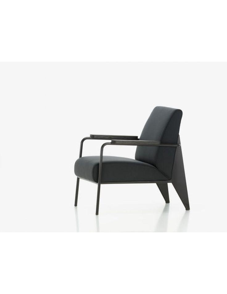 Vitra de Salon  De Vitra de Salon design fauteuil is een recent ontwerp van Jean Prouve. Het frame van de Salon fauteuil is vervaardigd uit staal en leverbaar in verschillende kleuren. De armleggers van deze fauteuil zijn vervaardigd uit eikenout (naturel of gerookt) of uit Amerikaans walnoot hout.