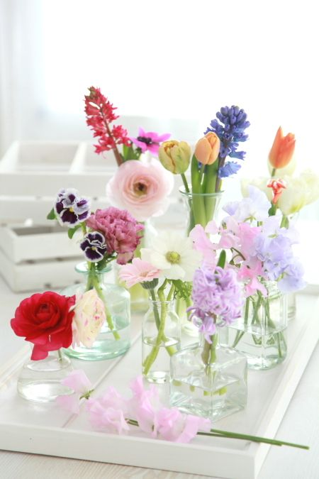 Fill clear glass vases with a variety of spring blooms. Pinned by Afloral.com from http://ameblo.jp/biseikatsu/entry-11481423298.html ~Afloral.com has high-quality faux flowers for your DIY wedding centerpieces.