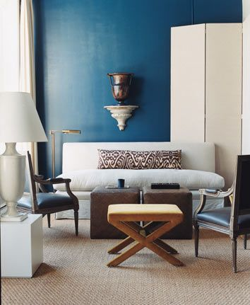 Peacock blue, makes this room calmer than it already is!! Love the combination of the tribal pillow print with the starkness of the tranquil wall!