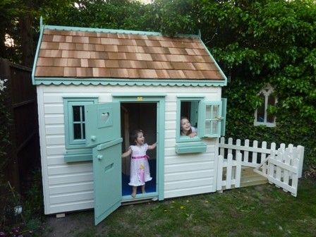 Cottage playhouse with decked area tree house for Wooden wendy house ideas