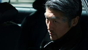 """""""Woman in Black""""- Akira Kimura arrives in Portland to meet with an investigator. Kimura is the last suspect in Nick's parents' killing. The investigator points out Nick, Hank, Captain Renard and Monroe were all involved in Marquesa's case and believes one of them now has the three gold Coins of Zakynthos. Kimura morphs into a Schakal and kills the investigator. Moments later, someone breaks into the room and finds the dead investigator. It's the woman in black with a hood over her head."""
