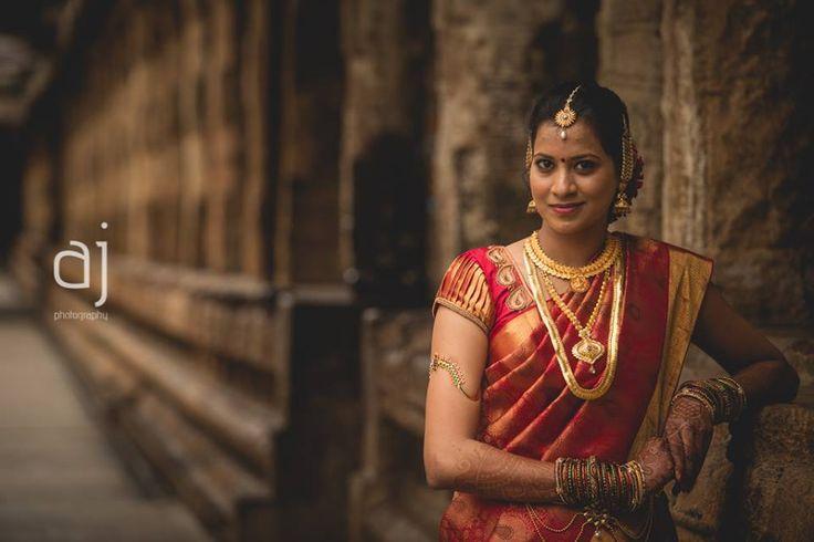 Traditional Southern Indian bride wearing bridal silk saree, jewellery and hairstyle. #IndianBridalMakeup #IndianBridalFashion. Temple jewelry. Jhumkis. Silk kanchipuram sari. Braid with fresh flowers. Tamil bride. Telugu bride. Kannada bride. Hindu bride. Malayalee bride Anbu Jawahar Photography.
