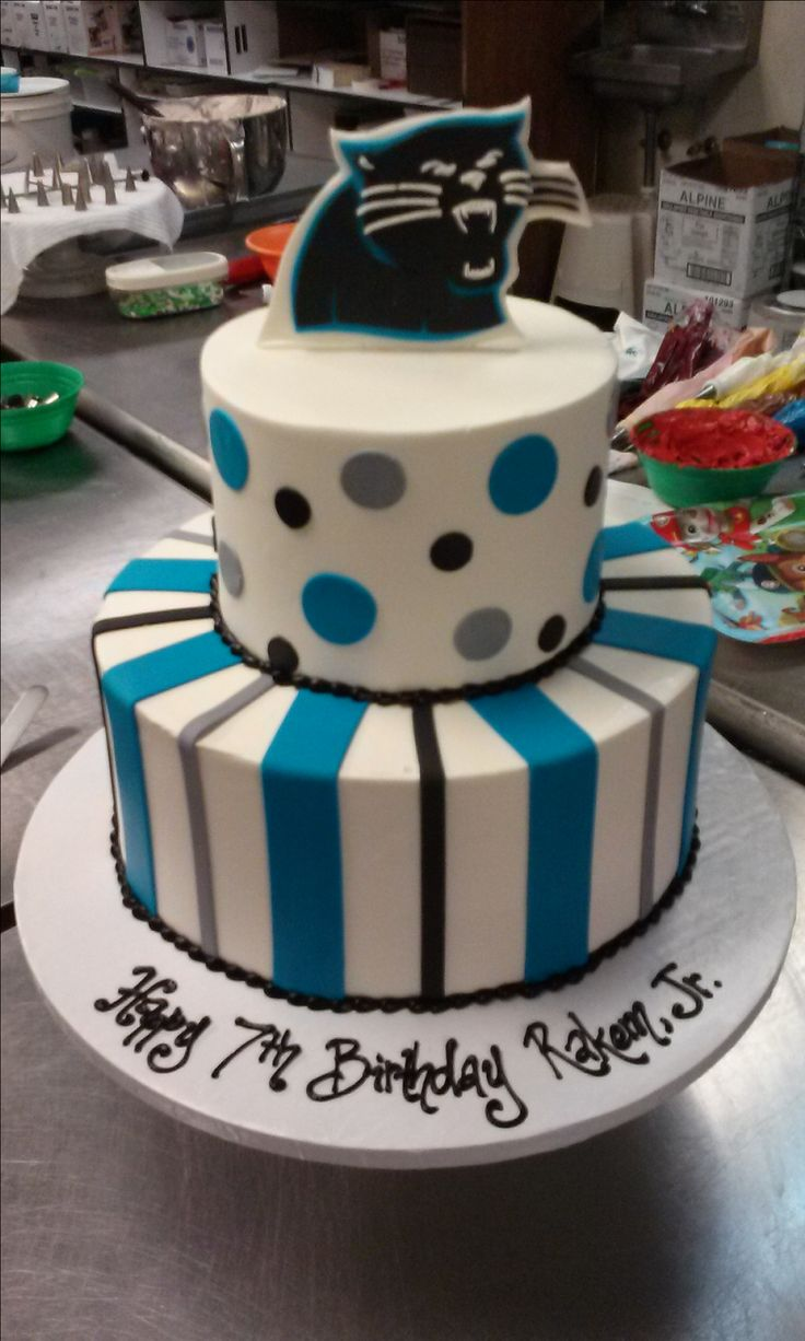 A Carolina Panthers inspired two tier cake with fondant panther topper, dots, and stripes.