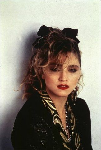 Madonna - LOVED her!  And I totally tried dressing like her!  Still want to be her when i grow up!