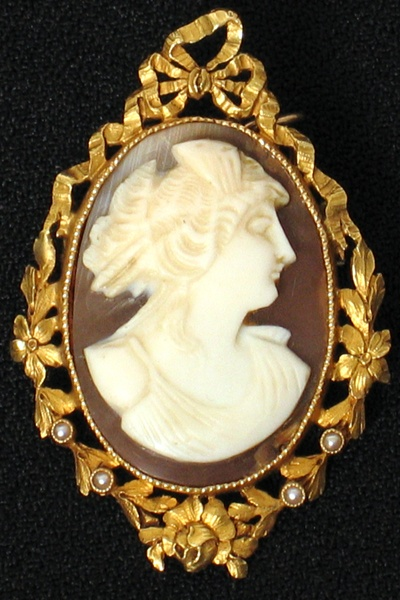 14K FRENCH NEOCLASSICAL SHELL CAMEO 14K 19th C. French neo-classical yellow gold framed cameo with pierced ribbon and floral wreath set with four seed pearls. Carved shell profile of Diana
