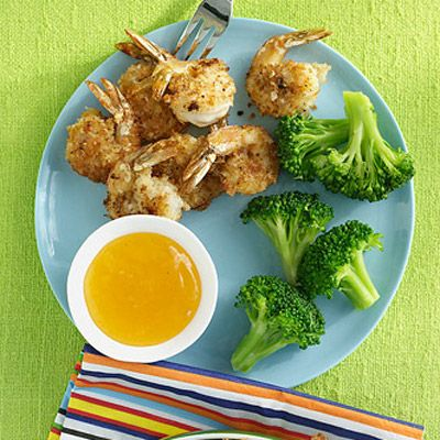 Crispy Coconut Shrimp-  Ingredients:       1 1/2 cups sweetened shredded coconut     3/4 cups plain dried breadcrumbs     2 large egg whites     1 1/2 pounds medium shrimp, peeled and deveined (tail on)     Coarse salt and ground pepper     4 cups vegetable oil     Bottled sweet-and-sour sauce, for serving     1/2 cup(s) plain yogurt     1 tablespoons freshly squeezed lime juice     1 teaspoon Dijon mustard     1/4 teaspoon curry powder, preferably Madras     Lime wedges, for serving…