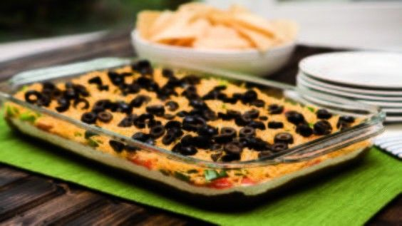 Don't get sacked for bad snacks at your next gameday party. Bring your A-game with this 7 Layer Taco Dip that will score big with your crowd!
