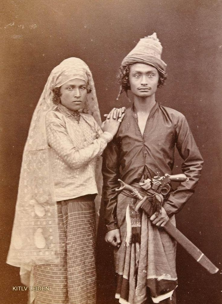 A young couple in 1880. The seemingly wealthy man is armed with a triple crowned Sikin sword and a Dutch Hembrug 1873 Revolver.