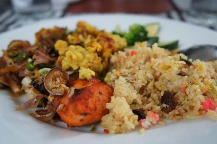 Briyani rice with tandori chicken and any varieties of salad. Srilanka food