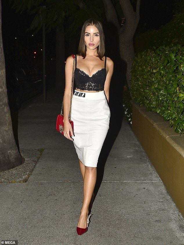 82a2a67758d Olivia Culpo shows off her figure in black lace bra and white skirt ...