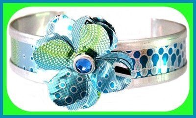 Recycled Fresca Small Flower Cuff Bracelet Cangles. $16.00. four sizes available. blue. Handmade. Made in the U.S.A.. recycled packaging