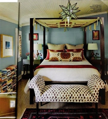 Eclectic bedroom...lots of character here!!  Love the stacks and stacks of books...cool canopy and matching pillow.