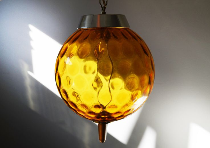 Mid Century Modern Amber Swag Globe Pendant Light - Brass and Teak accents, Hollywood Regency Retro hanging lamp circa 1960s by Trashtiques on Etsy https://www.etsy.com/ca/listing/451538192/mid-century-modern-amber-swag-globe