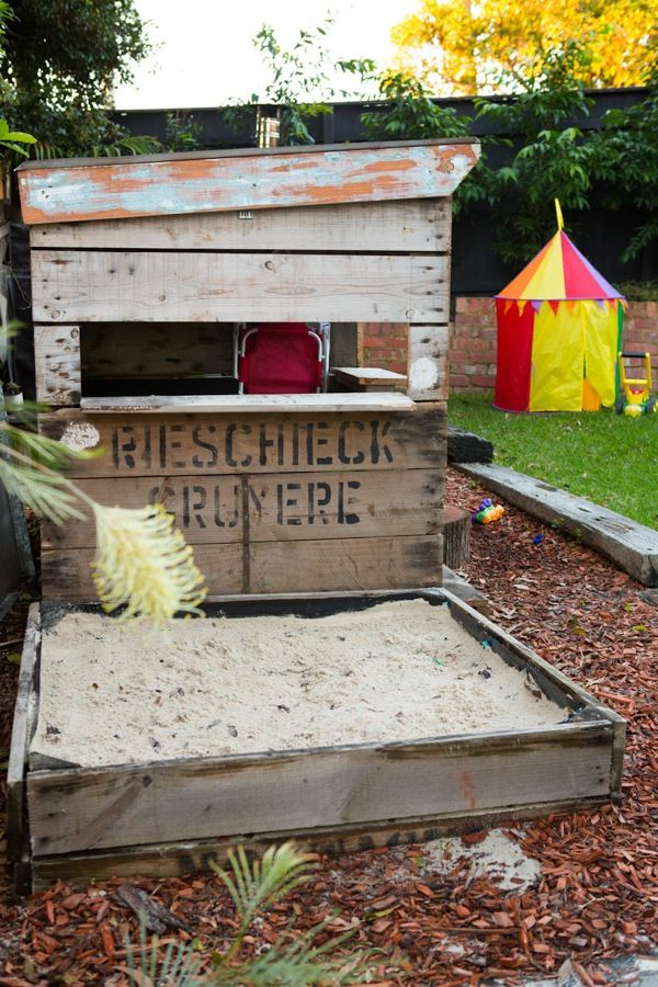 Our little cubby house with sand pit on the side. Perfect for making sand pies and serving them from the cafe windows.
