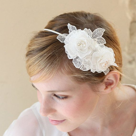 STYLE - #235 CODE:HDB014 Double lace roses headband features cream lace appliqués hand-rolled and sewn to its natural and organic rose shapes. Each roses are decorated with peal stamens and the colour of the stamens can be customised. To order yours, contact us on loca@localoca.co.za www.localoca.co.za