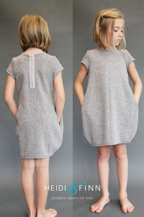 What a fun dress for your little girl! This pattern is for the Cocoon dress  The cocoon dress is a simple, comfy and modern staple in any little girls' closet. This jumper style dress has been updated with clean modern lines and a cocoon/bell style silhouette. Made with stable knits that focus on volume vs drape, this dress is incredibly easy to sew. The optional exposed zipper or colorblock front, and inseam pockets make this a very versatile design that you will want to sew over and over…