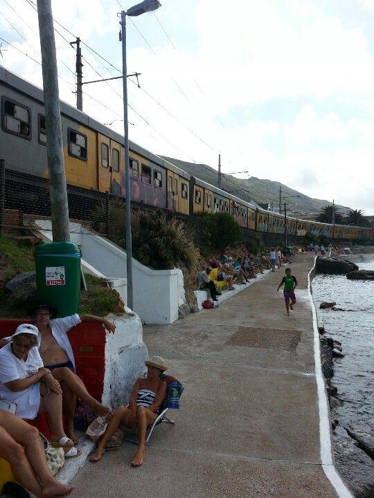Fish Hoek beach... train heading for Simonstown (Western Cape)