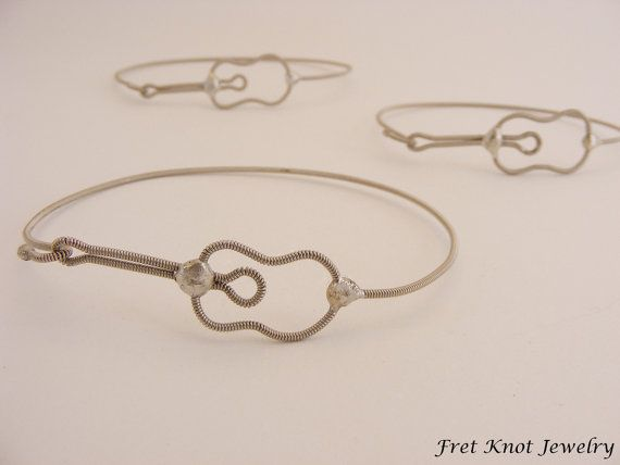Is this bracelet fun or what?! Its a sideways acoustic guitar bracelet that is so versatile. It can be great for girls, guys, bracelets, and anklets. Maybe even an armband. Someone requested I make a recycled guitar bracelet out of the strings, and I am so glad I did! The clasp slides into the head of the guitar from underneath. Its a little difficult to get on without practice, but it helps keep it from slipping open as well as keep the shape of the guitar. You can make your purchase in…
