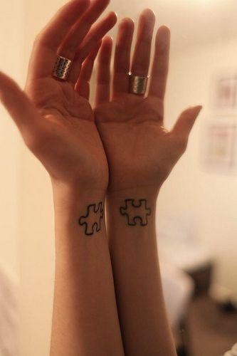 Nifty matching tattoos