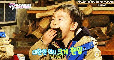 Daehannie laughs while eating seaweed