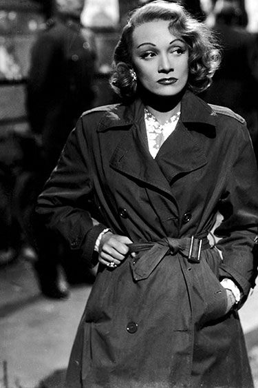 In the Trenches: Celebrity Trench Coats Through the Years - Marlene Dietrich, 1948 (black and white photos, famous actresses)