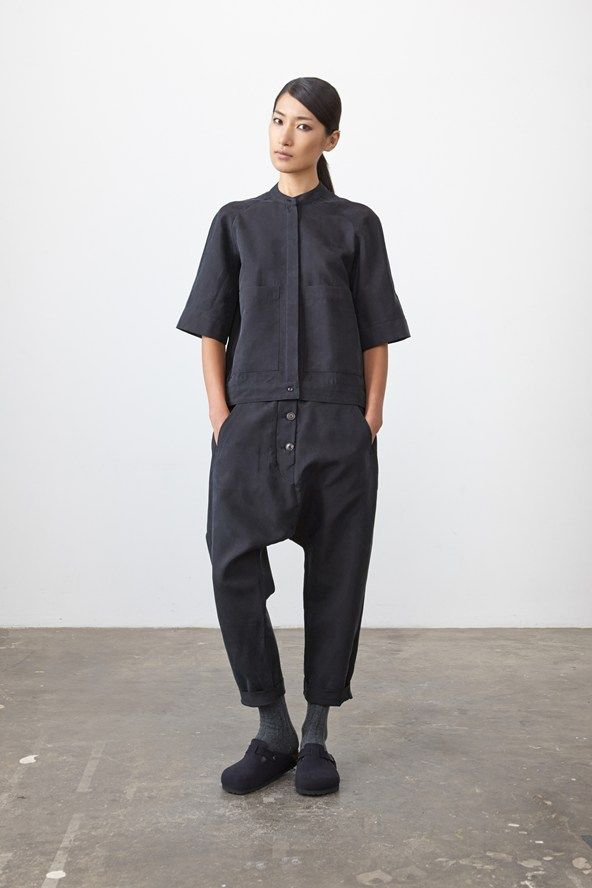 Black hidden placket shell shirt with dropped crotch cropped trousers w/ button closure