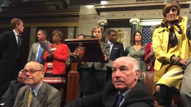 Members of Congress, including, front row, from left, Rep. Steve Cohen, D-Tenn., Rep. Joe Courtney, D-Conn., and Rep. Rosa DeLauro, D-Conn., participate in sit-down protest seeking a a vote on gun control measures