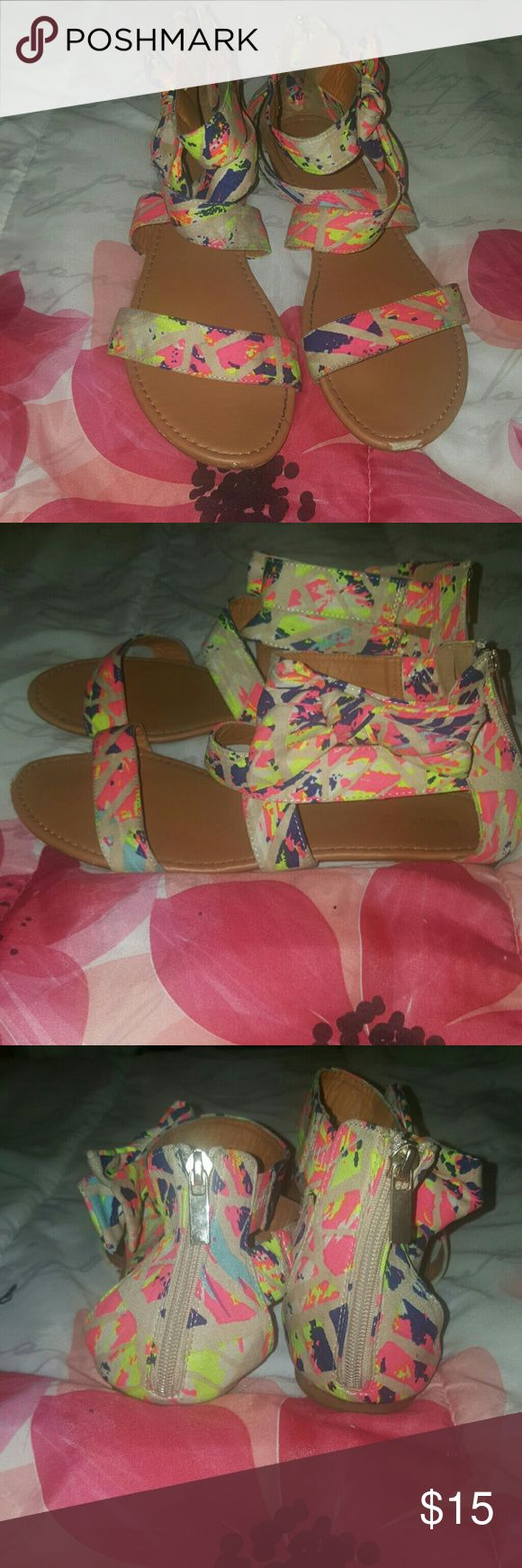Multi Color Splash Paint SANDALS SIZE 11 Splash paint print multi color sandals clean in good condition. Just needs wipe down on cloth print with babywipes or baking soda and water if dirty. Comfortable and stylish ankle sandal with bow detail.  defect scratch on toe of heel not noticeable when worn bamboo  Shoes Sandals