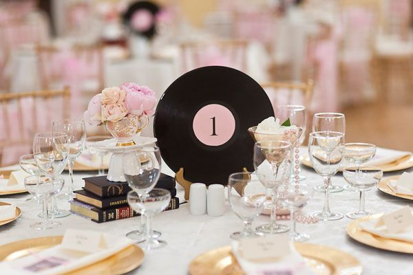 A vinyl record was just one of the vintage items bride and groom came across when they scoured local antique shops for centrepiece ideas.