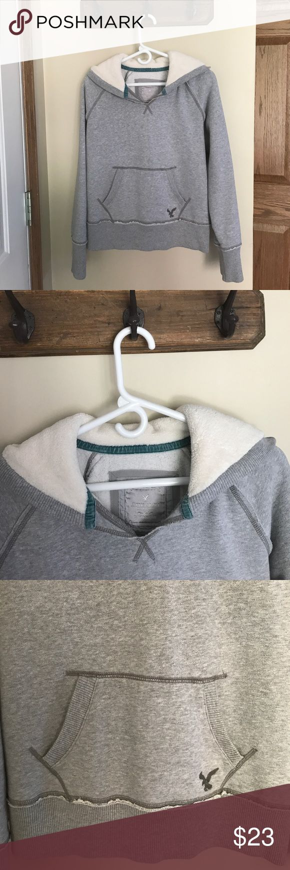 AMERICAN EAGLE OUTFITTERS Pullover Hoodie AMERICAN EAGLE OUTFITTERS Pullover hoodie.  Super cute and warm.  Hood is lined with soft material.  Pouch in front to keep hands warm or for storage.  Good condition no stains, holes or tears. American Eagle Outfitters Jackets & Coats