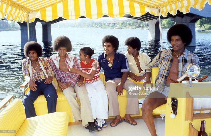 Janet Jackson (C) with her brothers (L-R) Marlon Jackson, Michael Jackson, Tito Jackson, Randy Jackson and Jackie Jackson of The Jacksons pose during a publicity photo shoot after the band signed to Epic Records, at Jackie Jackson's home on August 17, 1978 in Westlake Village, California.