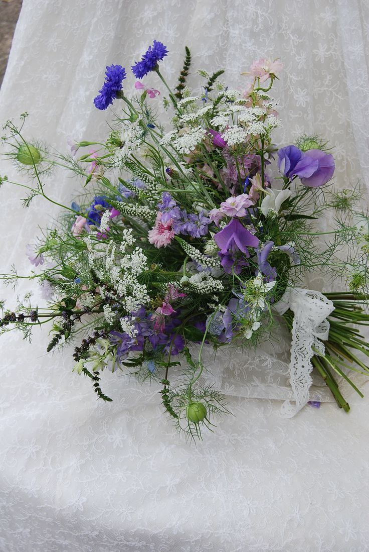 36 best nigella wedding flowers images on pinterest nigella the bouquet on the left is a beautifully scented bridal bouquet including blue white and dhlflorist Gallery