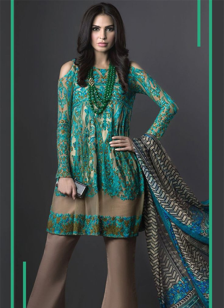 Mesmerizing Print Work Designer Suit  Be the attraction of everyone's eyes dressed with this ocean green georgette designer suit. The delightful weaved and print work all through the clothing is amazing. Accompanies coordinating bottom and dupatta.