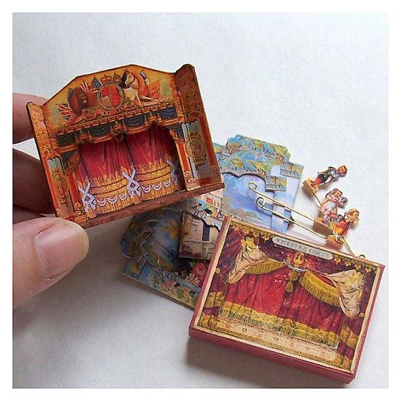 Dolls' House Miniature - Wooden Toy Theatre. comes complete with a curtain, 5 pieces of scenery and 3 characters for 'The Fairy Garden'