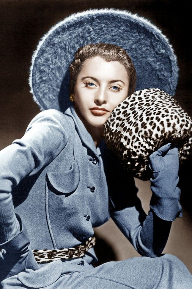 Barbara Stanwyck, 1940. Barbara rocks a tailored pastel blue suit in 1940 with a pop of leopard print. Lovely.