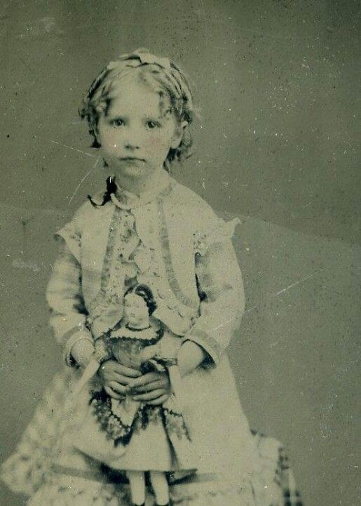 little girl with doll Is this your relative? Save your photos and the memories that they have permanently at MyFamilyVault.com